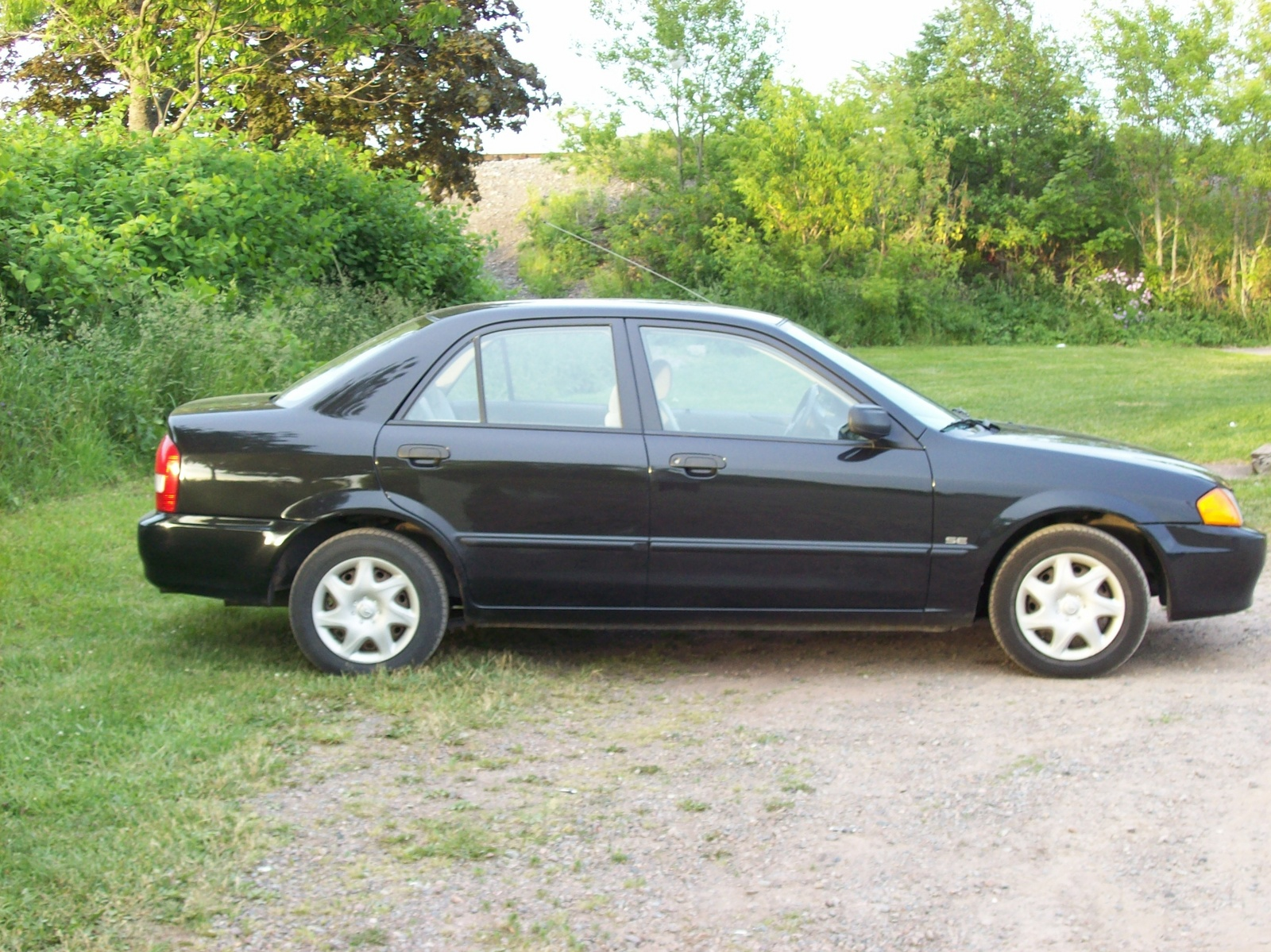 Black Mazda Capella 1995