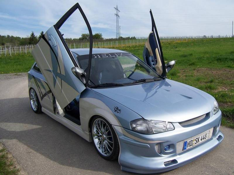 http://lookatthecar.org/wp-content/uploads/2015/09/Blue-Mazda-323F-1992-1712-15.jpg