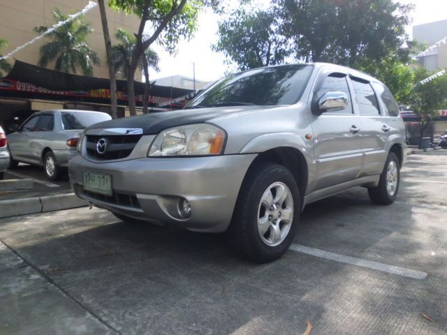 Green Mazda Tribute 2004