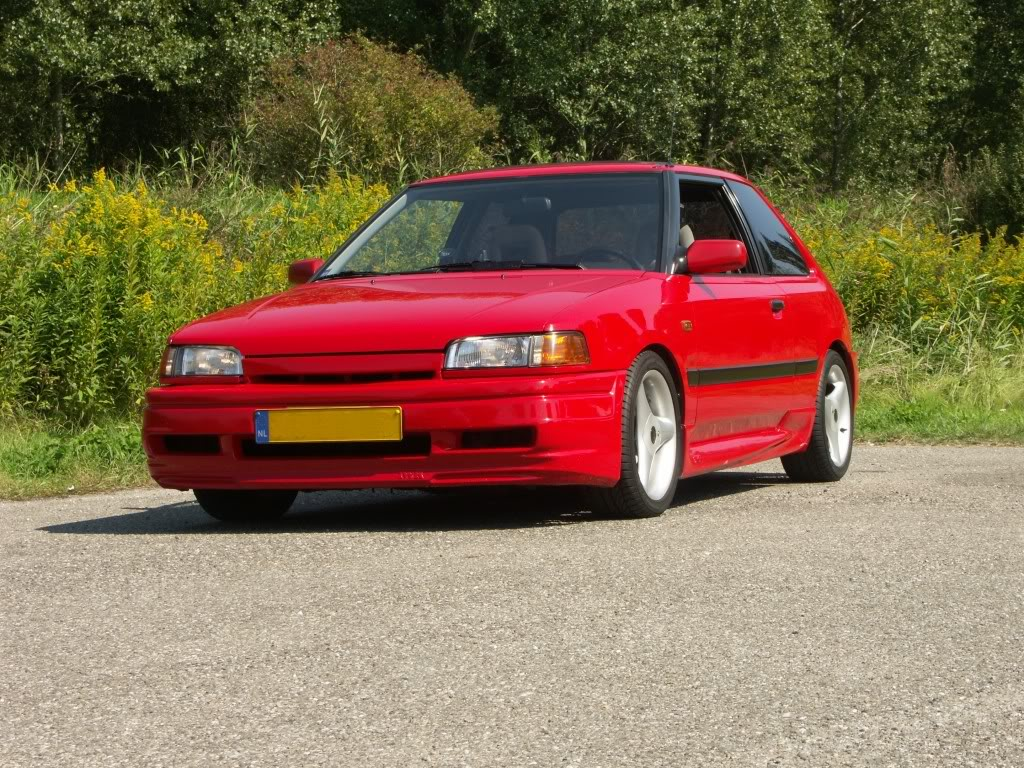 Red Mazda Capella 1988