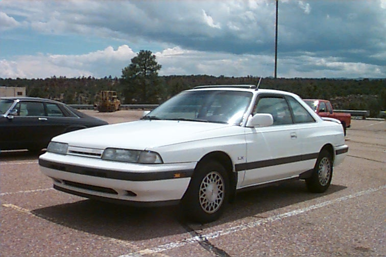 White Mazda Capella 1989