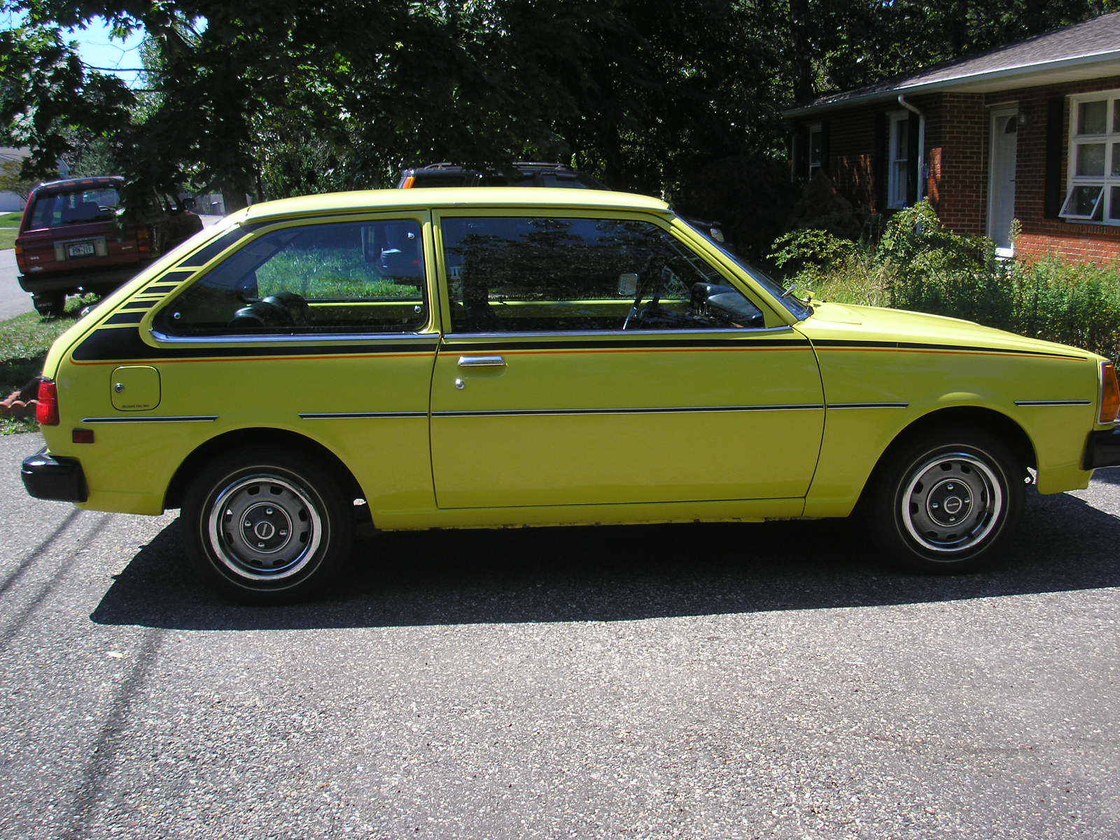 Yellow Mazda GLC 1980