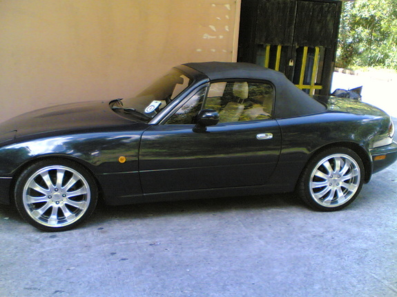 Yellow Mazda MX-5 1998