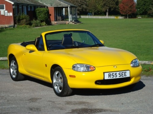 Yellow Mazda MX-5 2001