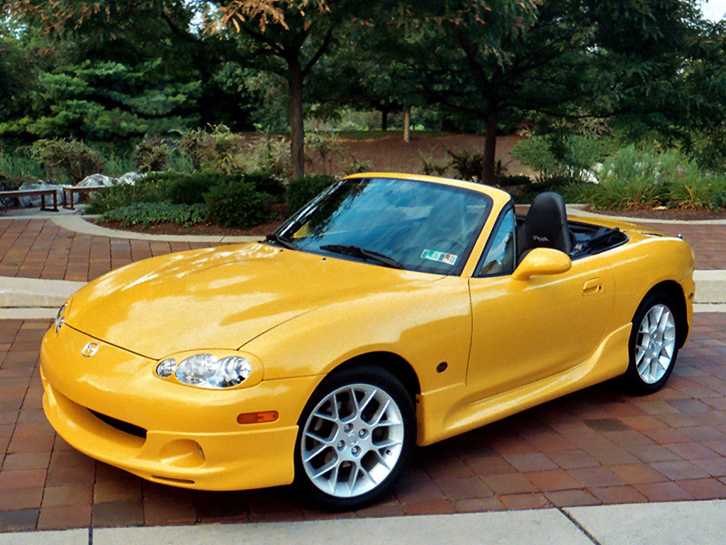 Yellow Mazda MX5 1998