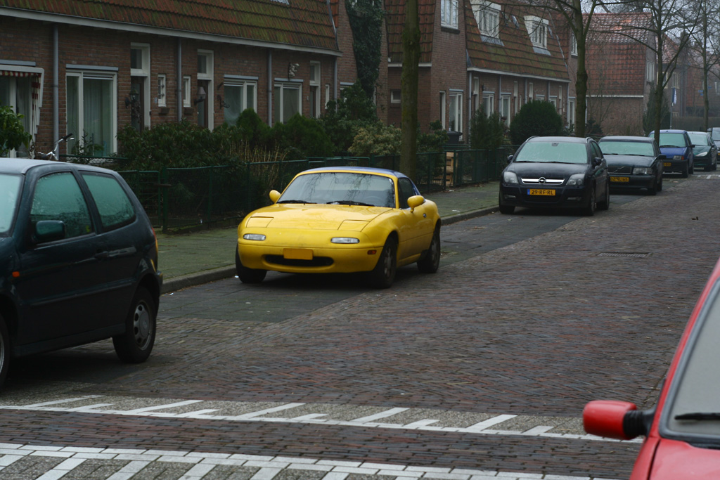 Yellow Mazda MX5 2010