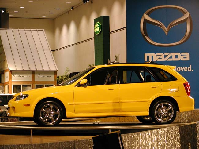 Yellow Mazda Protege 1997