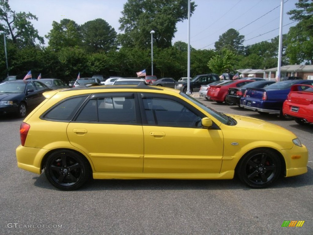 Yellow Mazda Protege 2001