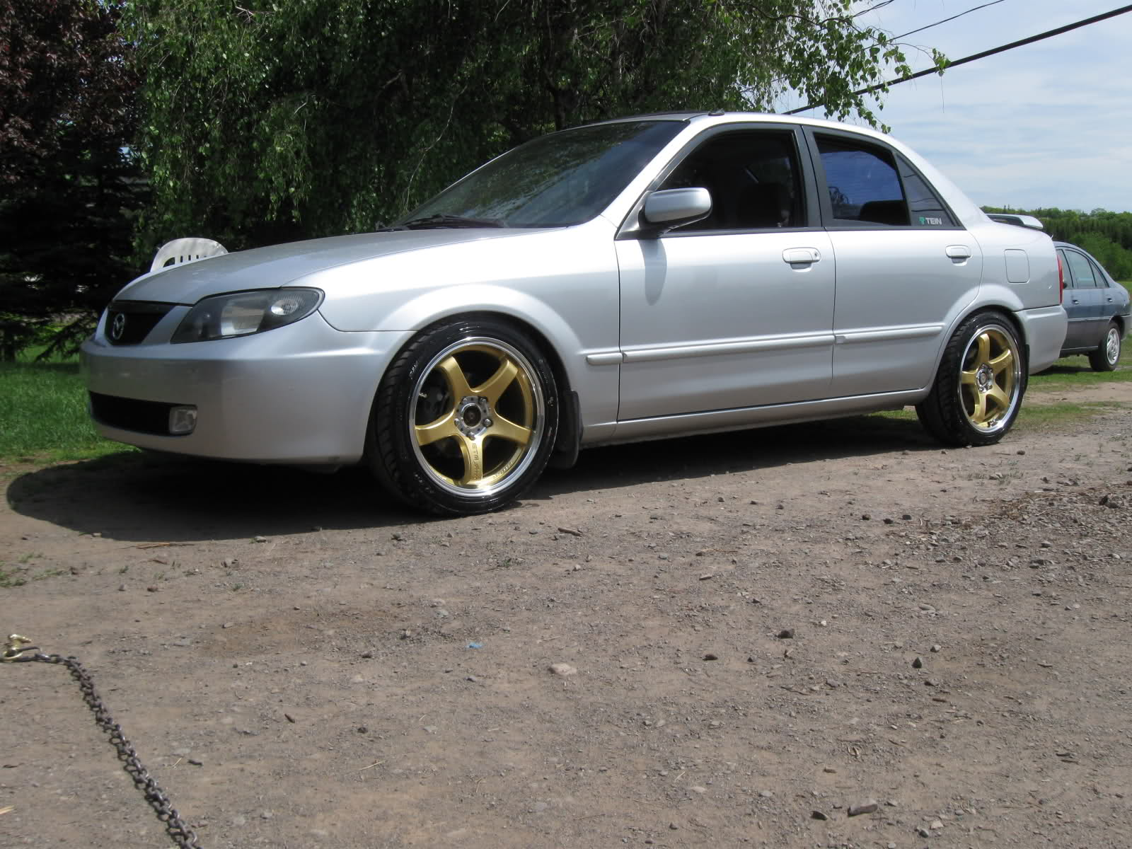 Yellow Mazda Protege 2007