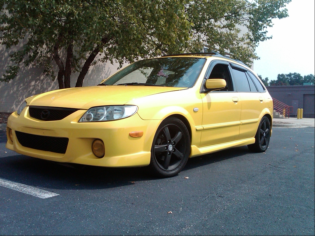 Yellow Mazda Protege5 2002