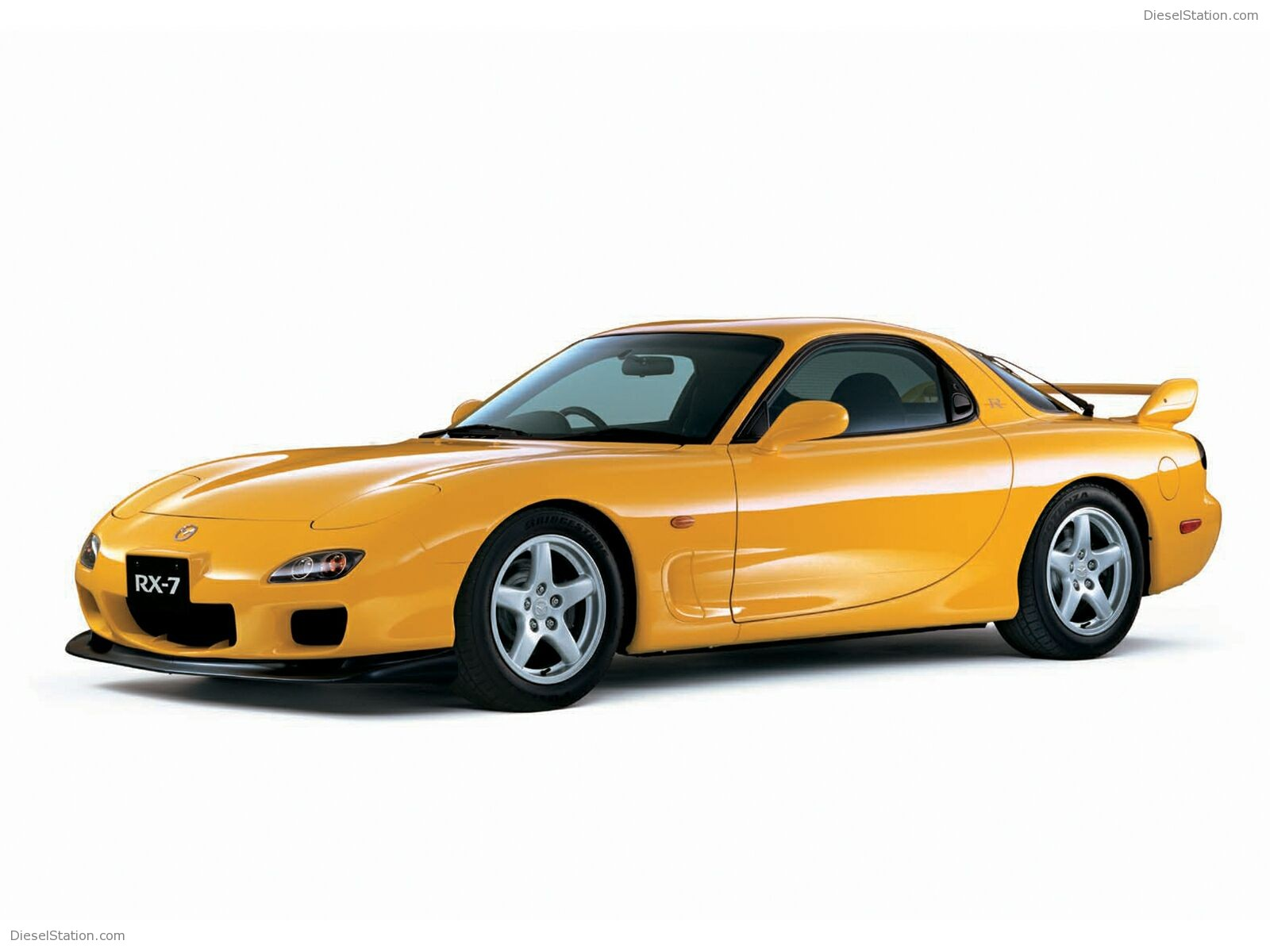 Yellow Mazda RX7 2000