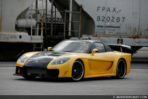 Yellow Mazda RX7 2010
