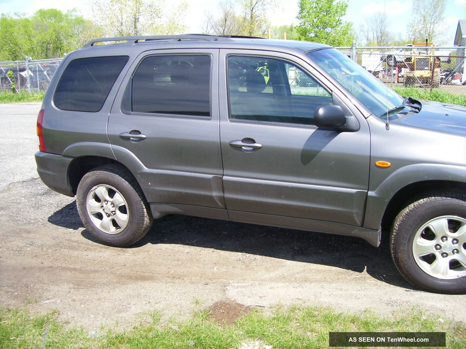 Yellow Mazda Tribute 2003